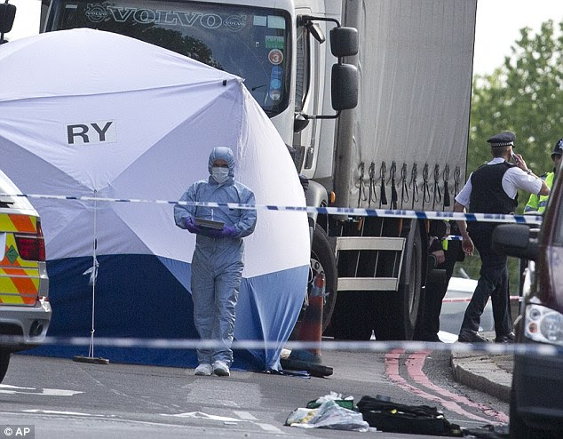 Investigations: A forensic tent is erected near the scene of the attack in Woolwich, south-east, London