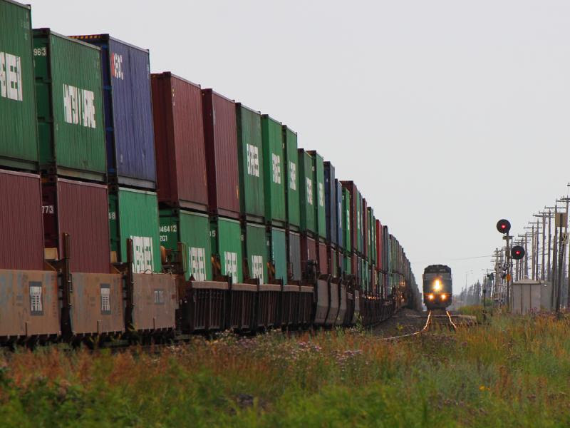 VIA 6413 passes a CN train