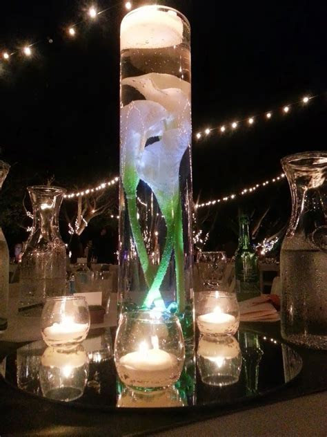 Calla Lilly in tall vase with water. Submersible LED light