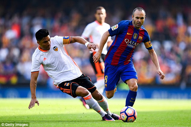 Andres Iniesta was involved in a tough tackle with Valenica's Enzo Perez