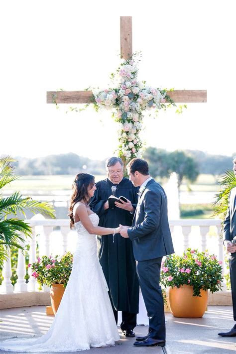 Wooden cross wedding ceremony backdrop that my husband