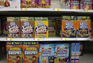 Boxes of Kellogg's cereal are displayed on store shelf …