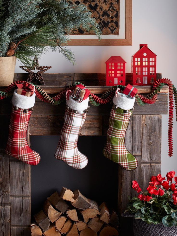 Plaid Christmas Stockings in different colors hanging on mantel (from Target) | Friday Christmas Favorites at www.andersonandgrant.com