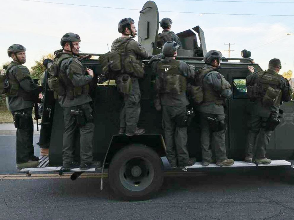PHOTO: A police SWAT team conducts a manhunt after a mass shooting in San Bernadino, Calif., Dec. 2, 2015.