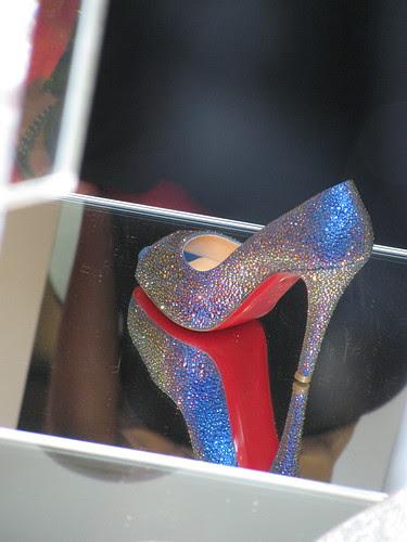 One Christian Louboutin shoe