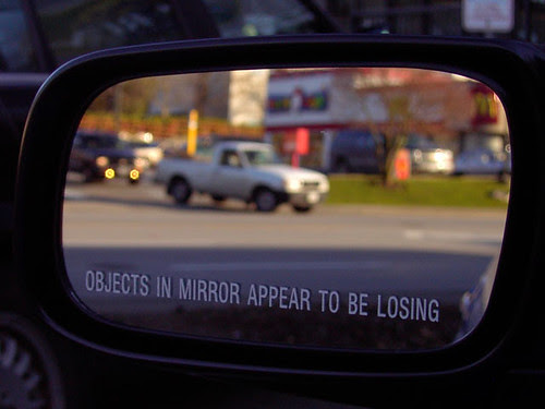 Objects in mirror appear to be losing