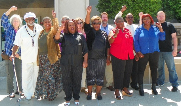 Rev. Pinkney's supporters outside Berrien County Courthouse May 31, 2014. His wife Dorothy Pinkney is fourth from left.