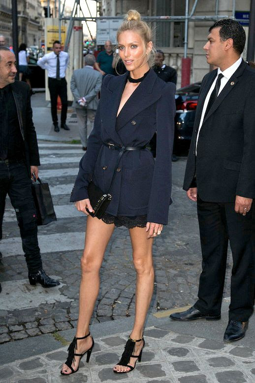 Le Fashion Blog Model Off Duty Date Night Style Anja Rubik Top Knot Choker Navy Belted Blazer Lace Hem Skirt Black Fringed Sandals Via Vogue