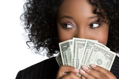 African american woman with curly hair holding money