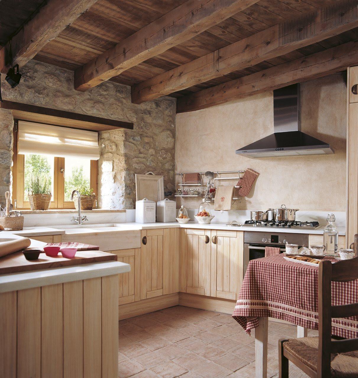 cocina rústica. Rústica cocina con vigas de madera y encimera de mármol blanco