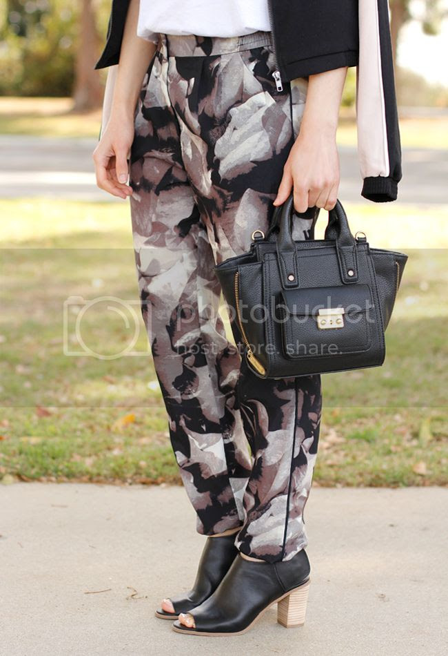 LA fashion blogger The Key To Chic wears Mossimo floral drapey trousers, Mossimo Kacie boots, a black Phillip Lim for Target mini satchel, and a Mossimo colorblock bomber jacket