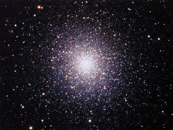 The great Globular Cluster of Hercules, also known as Messier 13 (or M13), is a large and bright spherical cluster of old stars that is readily seen with unaided eyes away from city lights. A telescope reveals the salt-spilled-on-velvet appearance.