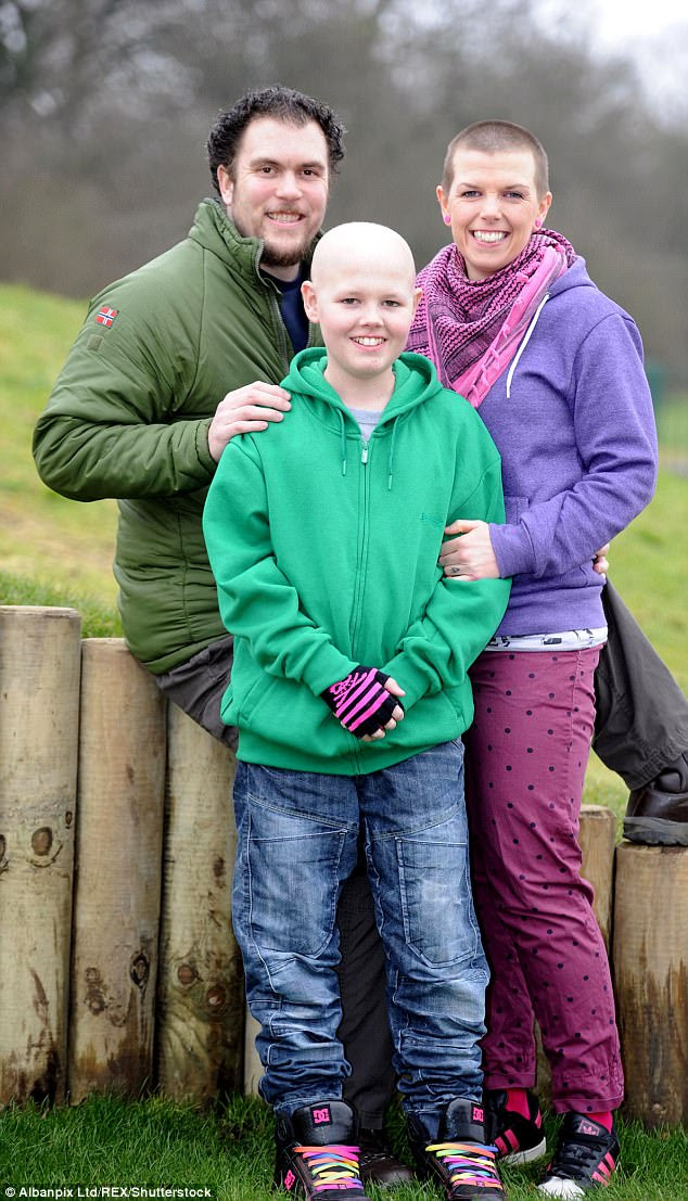 Deryn smiles with his mother Callie and father Simon in 2013