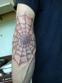 Grey Spider Web Tattoo On Elbow