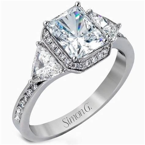 Simon G. Halo Emerald Cut Diamond Three Stone Trillion