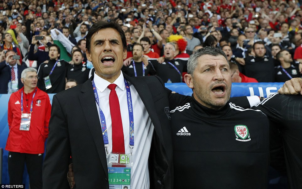 Coleman and his assistant manager Osian Roberts sing the national anthem before the game on an emotional night for Welsh football