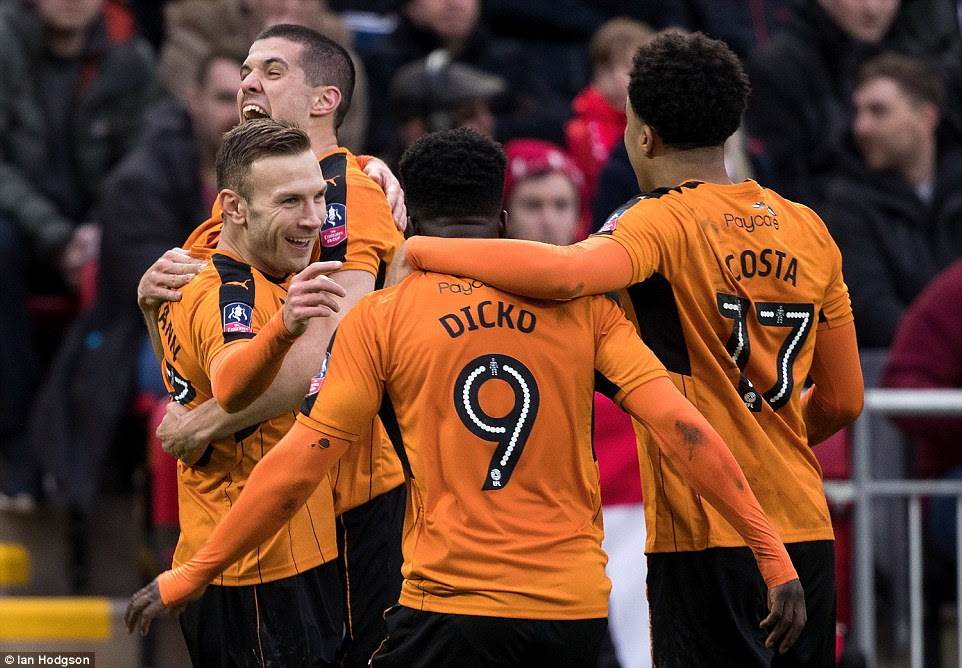 Weimann is embraced by team-mates Conor Coady, Nohua Dicko and Helder Costa after doubling Wolves' advantage