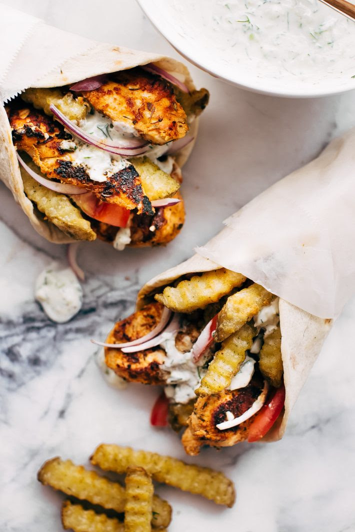 Easy Chicken Gyros with French Fries and Tzatziki Sauce - Learn how to make the easiest chicken gyros! Perfect for weeknight dinners! #chickengyros #gyros #gyrosrecipe #greekchicken | Littlespicejar.com