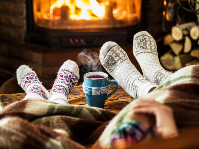 "Hygge, a Danish quality of ""coziness and comfortable conviviality,"" is making inroads with an international audience and is the subject of a crop of new books."