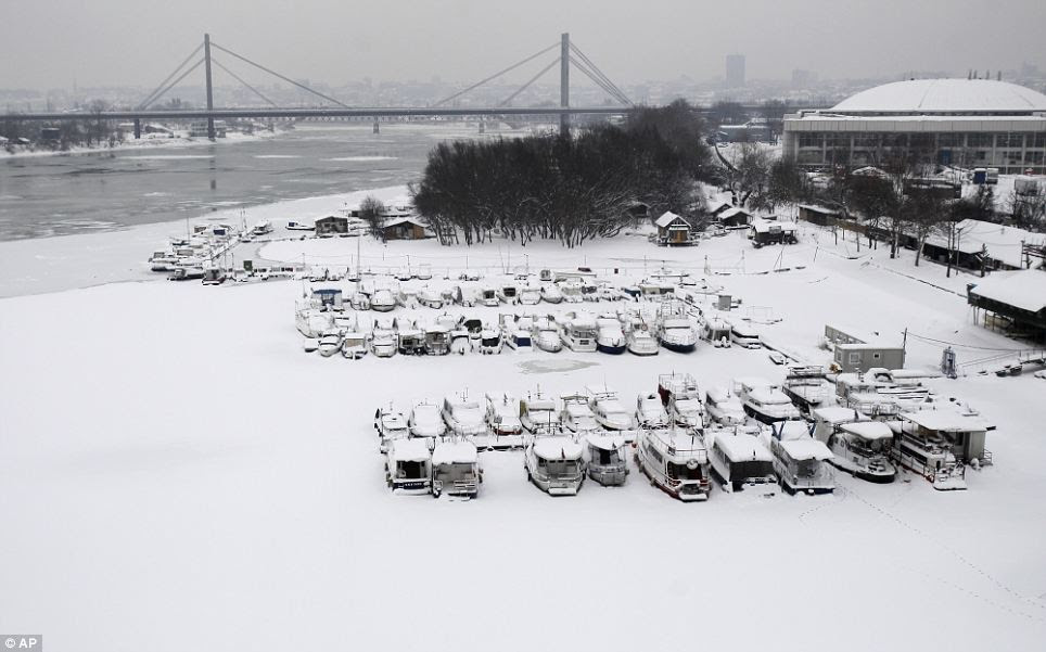 Snow covers boats on a frozen section of the Sava river in Belgrade, Serbia