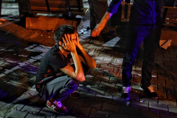 A relative of a Ataturk Airport suicide bomb attack victim waits dejectedly outside Bakirkoy Sadi Konuk Hospital