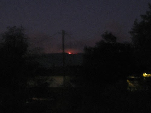 Flames creep over the mountain