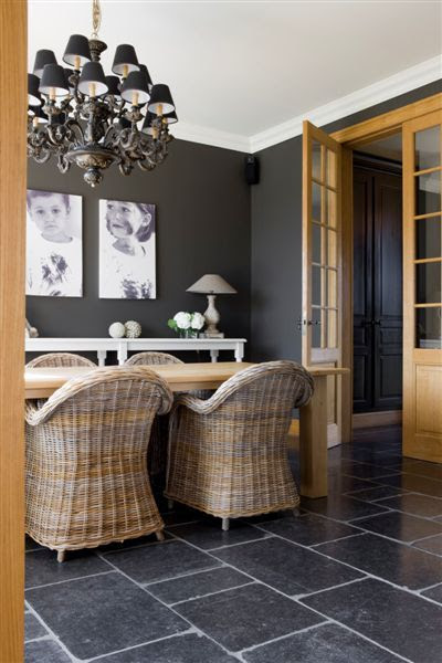 belgian bluestone flooring with charcoal grey walls, wicker chairs and a rustic table,