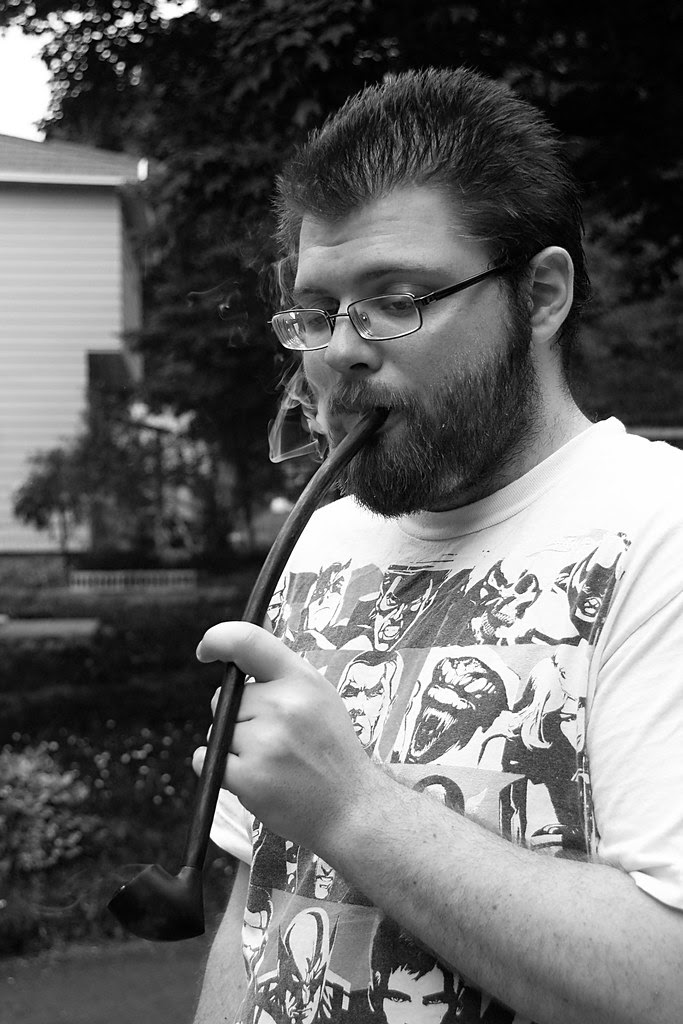 My housemate Adam smoking a long pipe.