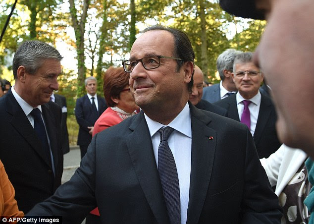 The French president (pictured today) has vowed to dismantle the Calais camp by the end of the year
