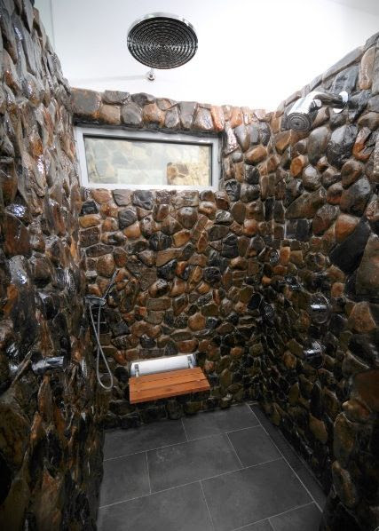 Stone shower...wow. Click to view the whole bathroom.