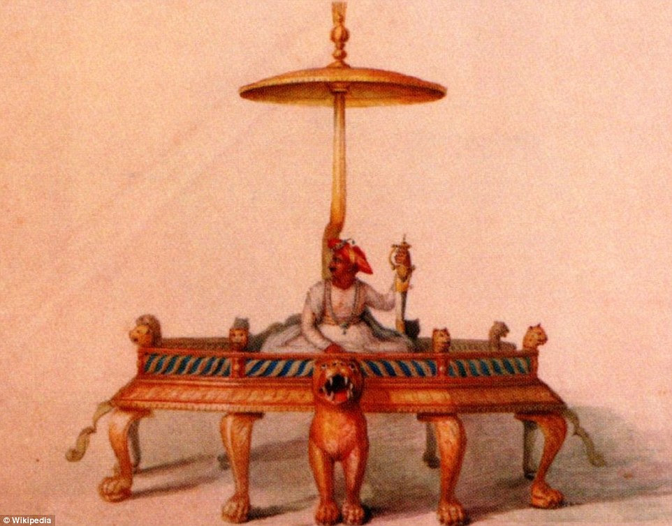 Atop of an empire: This historic picture shows what Tipu's magnificent throne would have looked like before he was toppled. On sale in the auction is the only surviving piece of the magnificent throne, a decoratively carved tiger foot with a silver plaque celebrating the victory