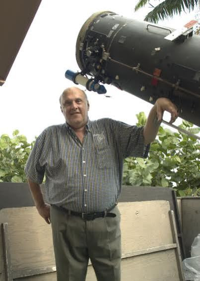 Don Parker with his 16-inch telescope, which he used to take thousands of superb images of the planets. Photo by Sean Walker.