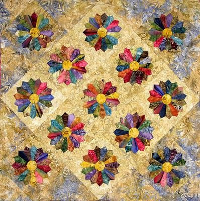 Edyta Sitar shows us a contemporary Dresden Plate quilt, using rich, deep batik colors.