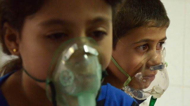 Children, affected by what activists say was a gas attack, breathe through oxygen masks in the Damascus suburb of Saqba, August 21, 2013