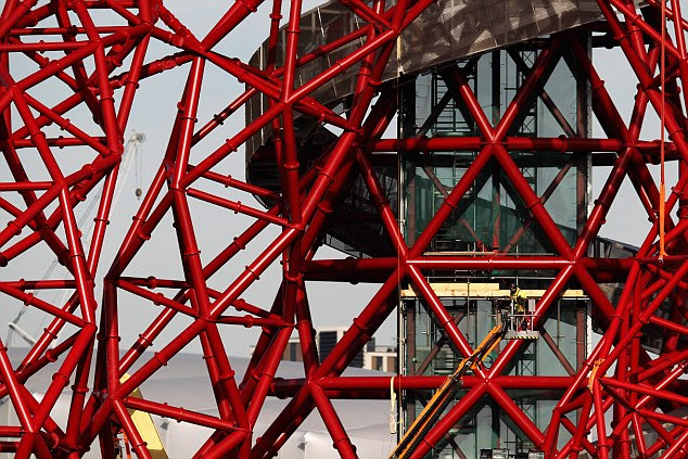 Intricate: The glass lift shaft that will carry visitors to the two observation platforms can be seen through the web of steel beams
