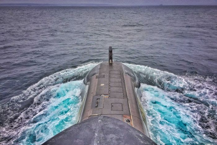 HMAS Waller rises to the surface of the ocean
