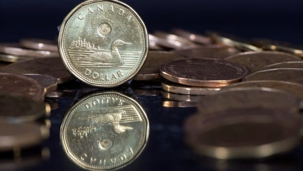 The Canadian dollar fell and the greenback rose on Monday as investors awaited election results.