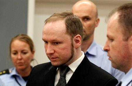 Norwegian mass killer Breivik reacts as he returns after a break to the court room, in Oslo Courthouse