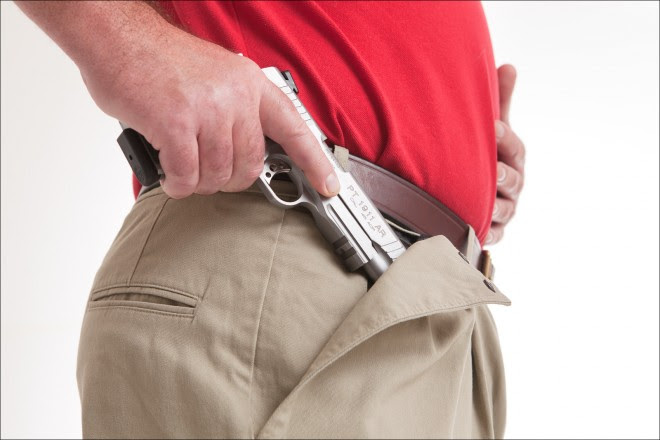 """Full-size 1911 -- or two, one on each side -- work fine for my 6'2"""" friend."""