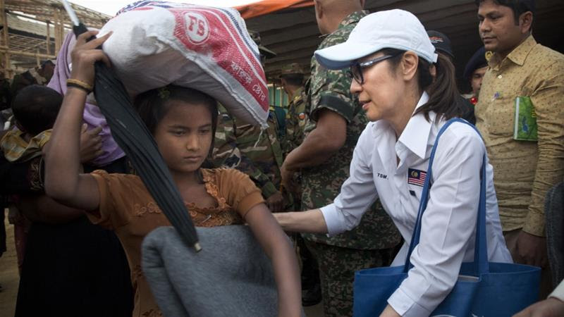 Malaysian actress Michelle Yeoh visited sprawling refugee camps in Bangladesh's Cox's Bazar on Saturday [Photo/Manish Swarup/AP]