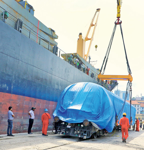 The Transport and Civil Aviation Ministry will import new passenger compartments, fuel carriages and flatbeds to enhance railway passenger and freight services.The first set of train units were unloaded at the Colombo Port yesterday. Picture by Saman Sri Wedage