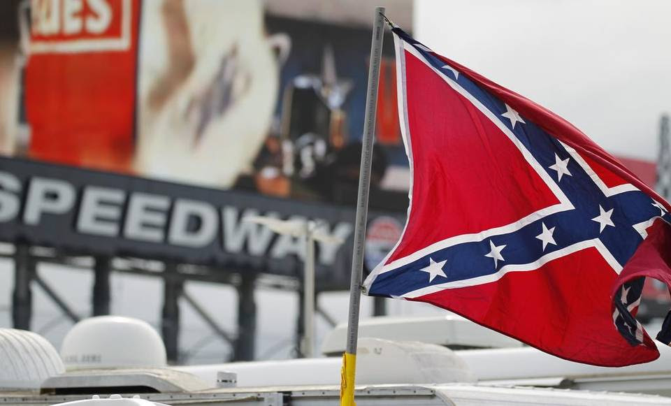 A handful of Confederate battle flags flew in the infield of Texas Motor Speedway before the NASCAR Xfinity Series O'Reilly Auto Parts Challenge.