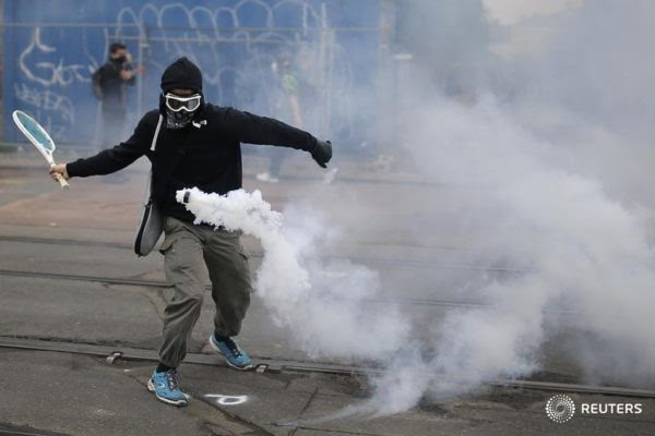 Stephane Mahe/Reuters: A protester in Nantes, France, used a tennis racket to return a tear gas canister in a demonstration on Thursday against proposed changed in French labor laws.
