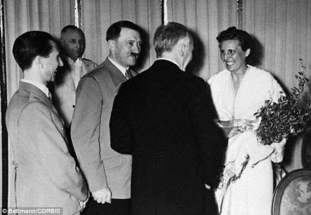 Culture: Hitler and Goebbels (far left), here with actress Leni Riefenstahl, amassed large art collections together