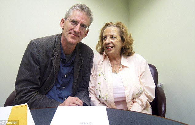 Kris's wife Marita, pictured right in Miami with lawyer Clive Stafford Smith, has stood by her husband since his arrest
