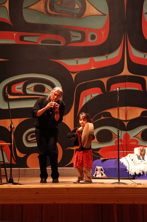 Gene Tagaban and a young audience member perform in Sitka, Alaska