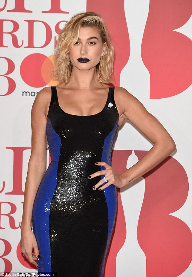 Sultry: She styled her blonde locks into a sweeping side-parting and amped up the fashion stakes with a bold black lip