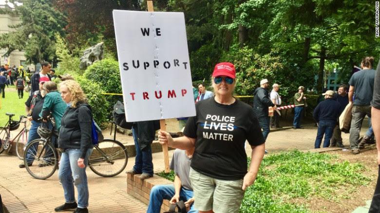 Debbie Sluder says she came out to bring people together.