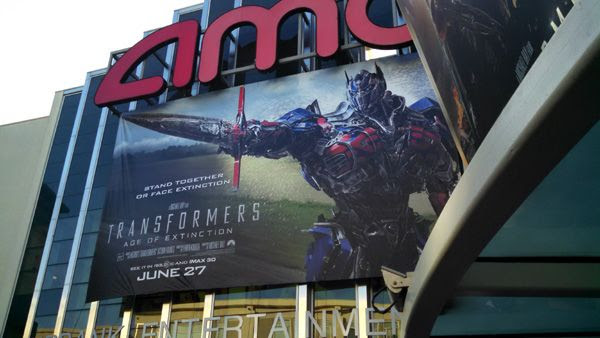 An advertisement for TRANSFORMERS: AGE OF EXTINCTION outside the AMC 16 theater in Burbank, California.