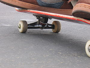 The underside of a skateboard. In this photo t...